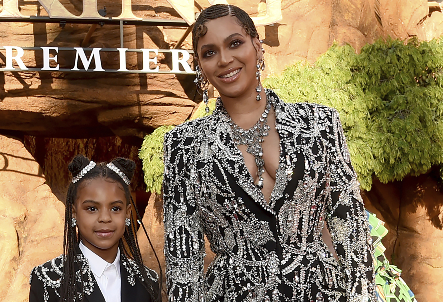 """Beyonce, right, and her daughter Blue Ivy Carter arrive at the world premiere of """"The Lion King"""" in Los Angeles on July 9, 2019. (Chris Pizzello/Invision/AP, File)"""