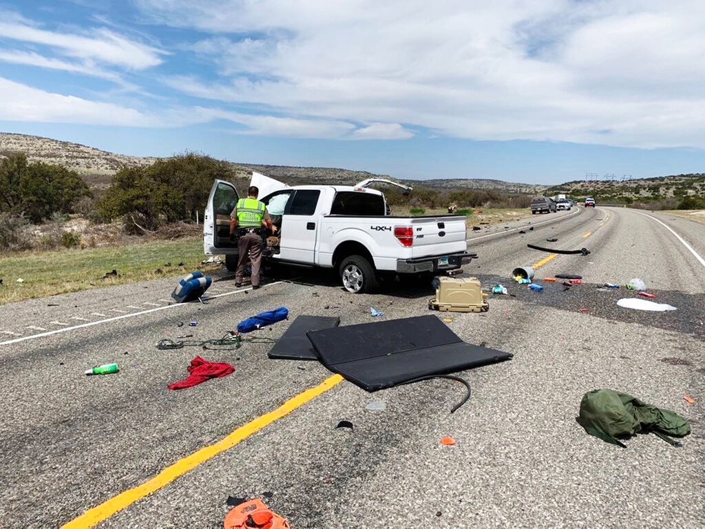 Debris is strewn across a road near the border city of Del Rio, Texas after a collision Monday, March 15, 2021. (Texas Department of Public Safety via AP)