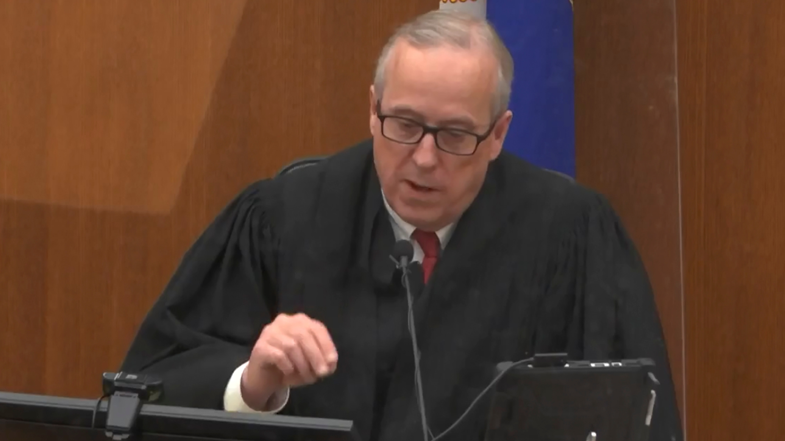 In this screen grab from video, Hennepin County Judge Peter Cahill presides over jury selection, Wednesday, March 17, 2021, in the trial of former Minneapolis police officer Derek Chauvin, in the May 25, 2020, death of George Floyd at the Hennepin County Courthouse in Minneapolis, Minn. The Judge dismissed a juror seated for ex-officer's trial who said $27M settlement to Floyd family would skew judgment. (Court TV, via AP, Pool)