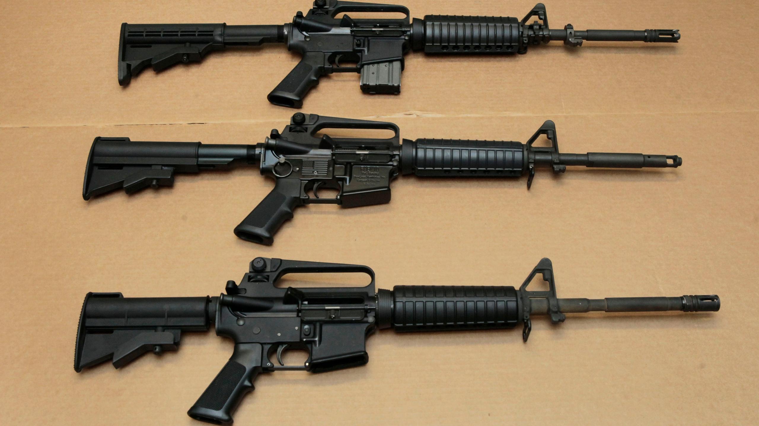 In this Aug. 15, 2012 file photo, three variations of the AR-15 assault rifle are displayed at the California Department of Justice in Sacramento. (Rich Pedroncelli/Associated Press)