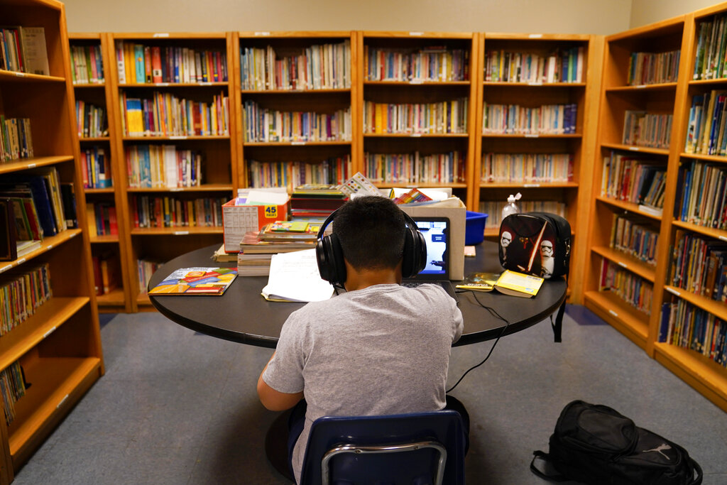 In this Aug. 26, 2020, file photo, a Los Angeles Unified School District student attends an online class at the Boys & Girls Club of Hollywood in Los Angeles. (AP Photo/Jae C. Hong, File)