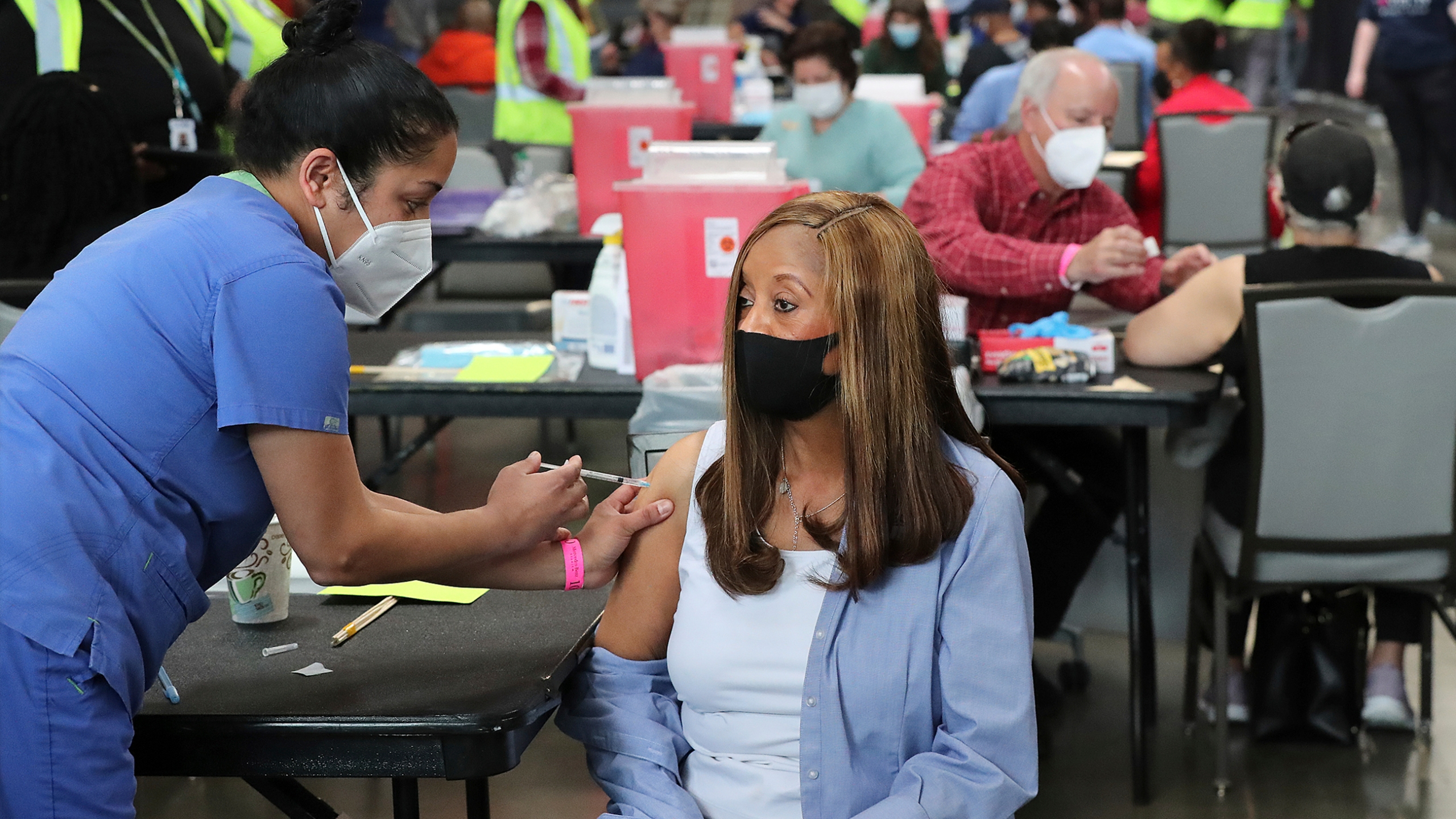In this March 23, 2021, file photo, Anita Shetty, left, vaccinates Doris Lucas with a Pfizer vaccine in Atlanta. More than three months into the U.S. vaccination drive, many of the numbers paint an increasingly encouraging picture as dozens of states have thrown open vaccinations to all adults or are planning to do so in a matter of weeks. (Curtis Compton/Atlanta Journal-Constitution via AP, File)