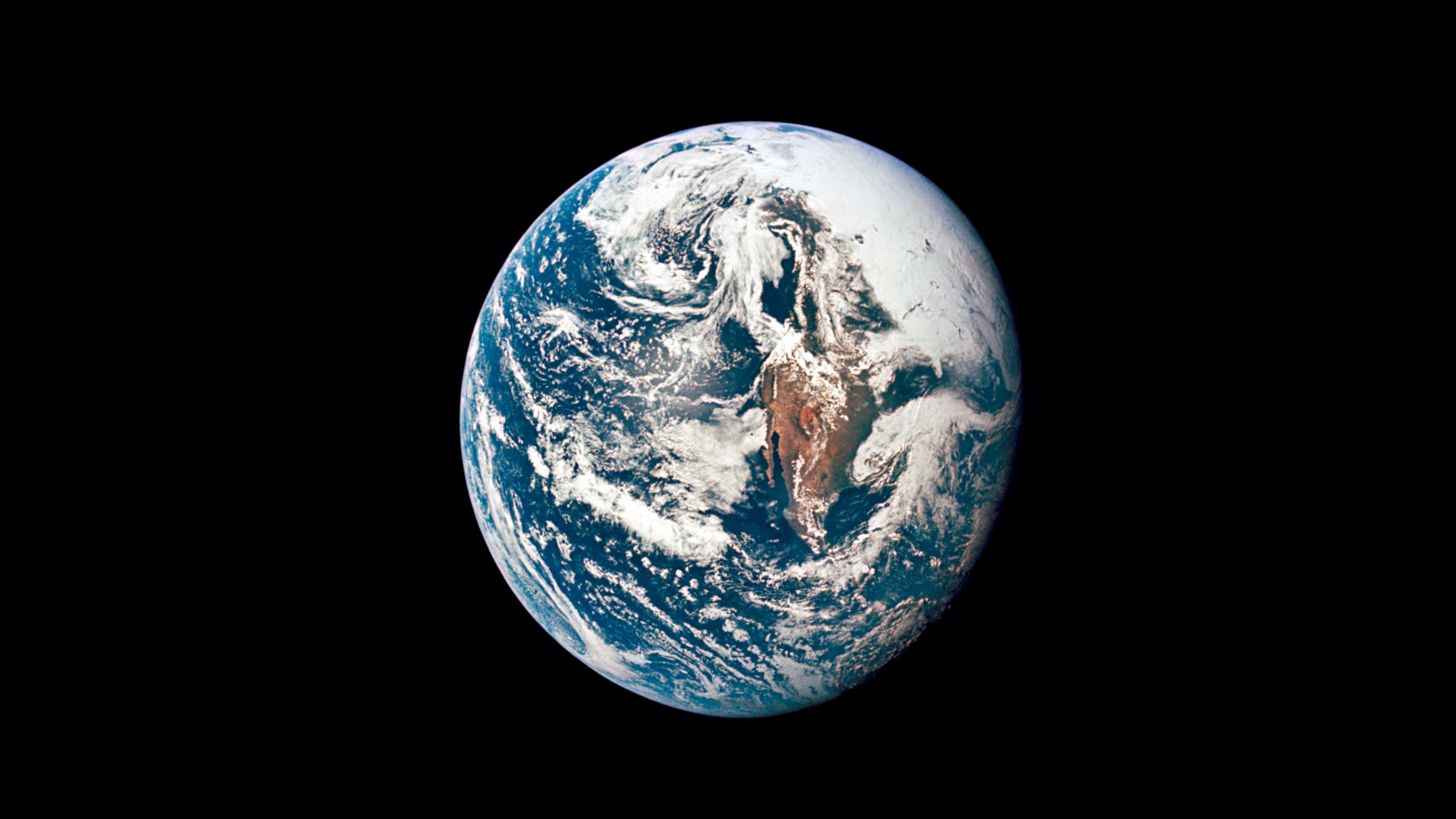This May 18, 1969 photo made available by NASA shows Earth from 36,000 nautical miles away as photographed from the Apollo 10 spacecraft during its trans-lunar journey toward the moon. In March 2021, the U.S. space agency announced that new telescope observations have ruled out any chance of the asteroid Apophis colliding with Earth in 2068. (NASA via AP)