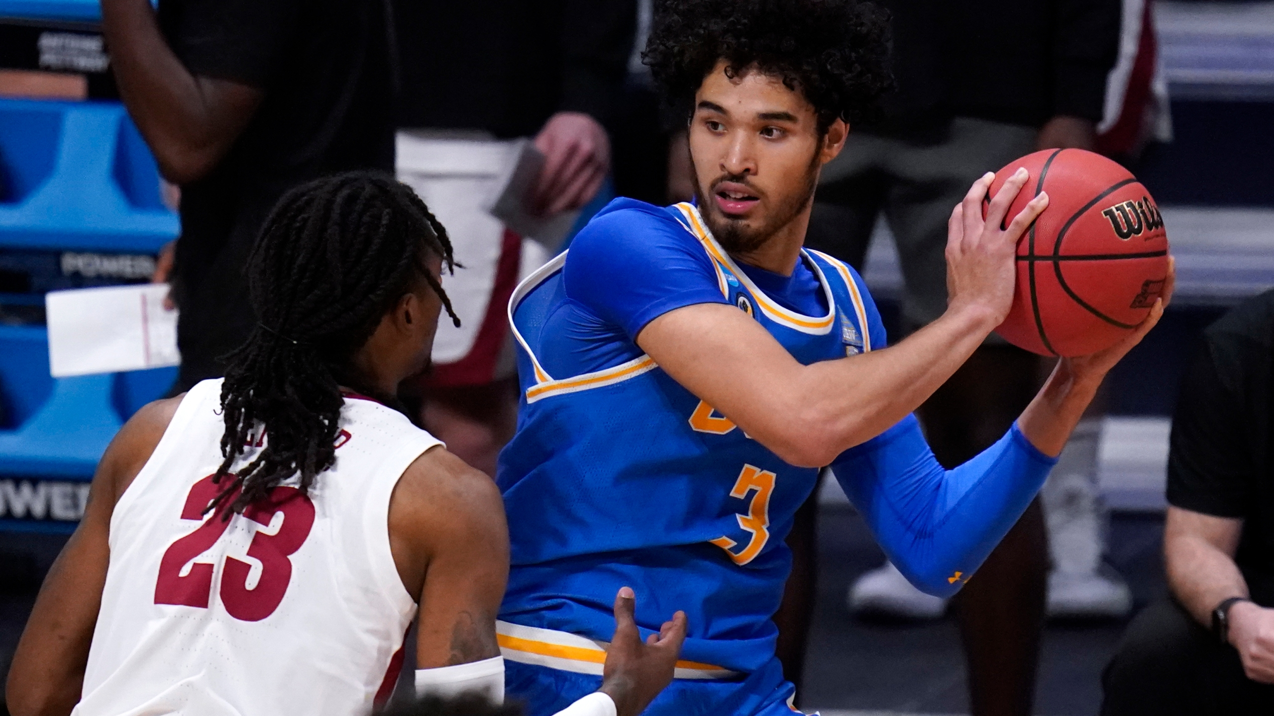 UCLA guard Johnny Juzang (3) protects the ball from Alabama guard John Petty Jr. (AP Photo/Michael Conroy)