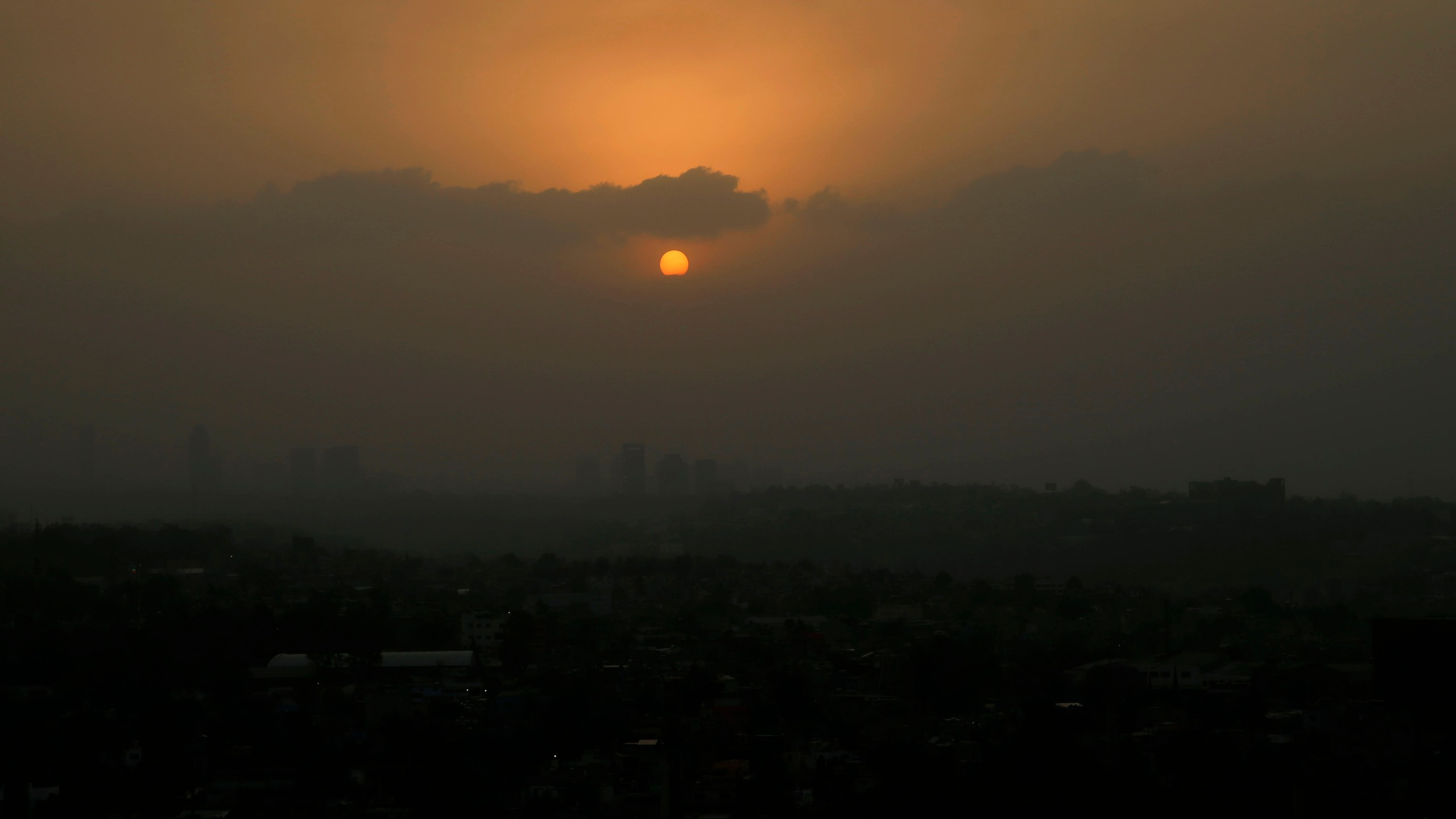 The sun sets amid a dust storm in Mexico City, Sunday, March. 28, 2021. (AP Photo/Marco Ugarte)
