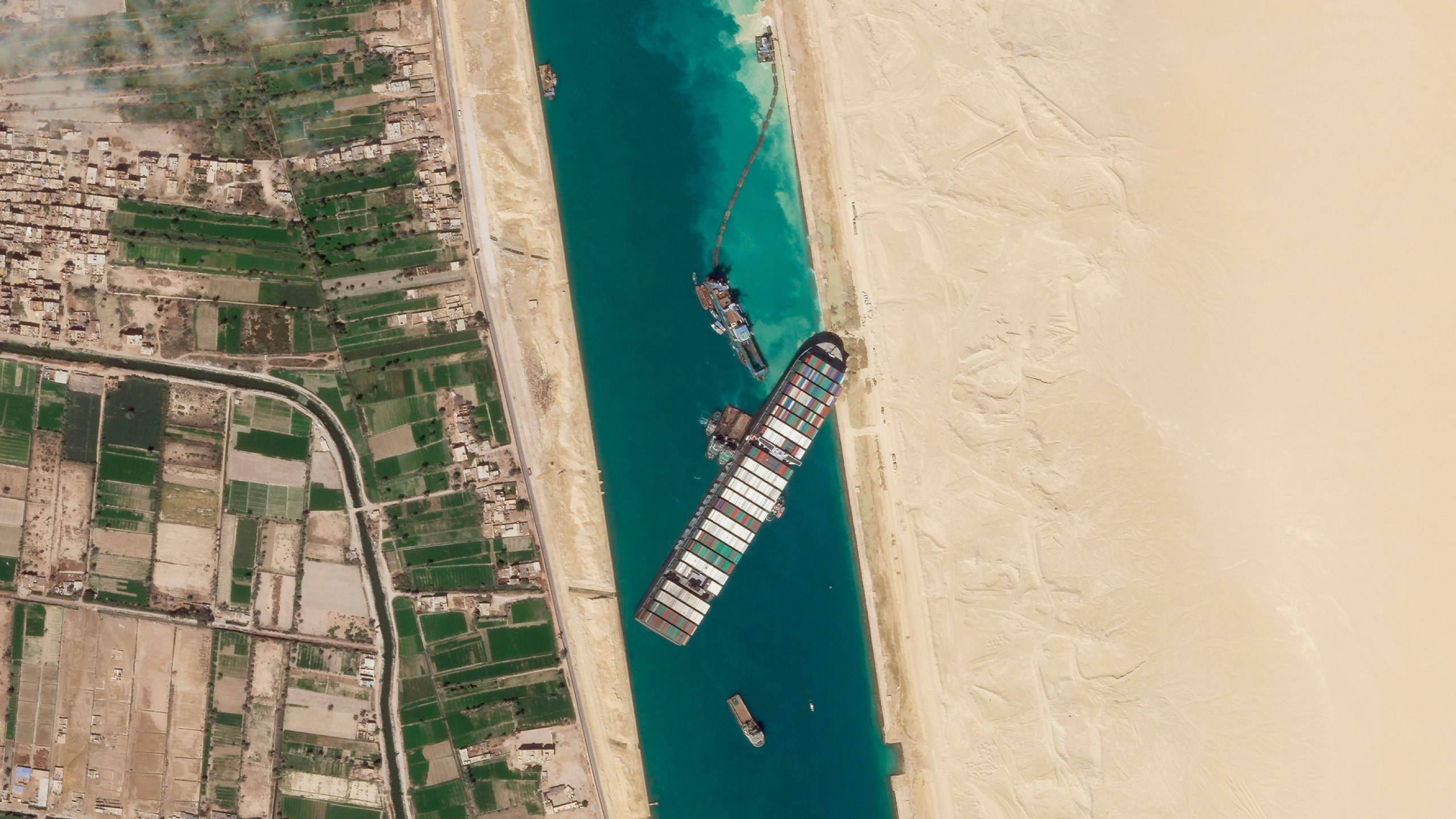 In this March 28, 2021, satellite file image from Planet Labs Inc, the cargo ship MV Ever Given sits stuck in the Suez Canal near Suez, Egypt. (Planet Labs Inc. via AP)
