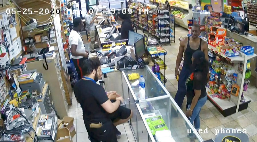 In this image from store video, George Floyd, right, is seen inside Cup Foods on May 25, 2020, in Minneapolis. (Court TV via AP, Pool)
