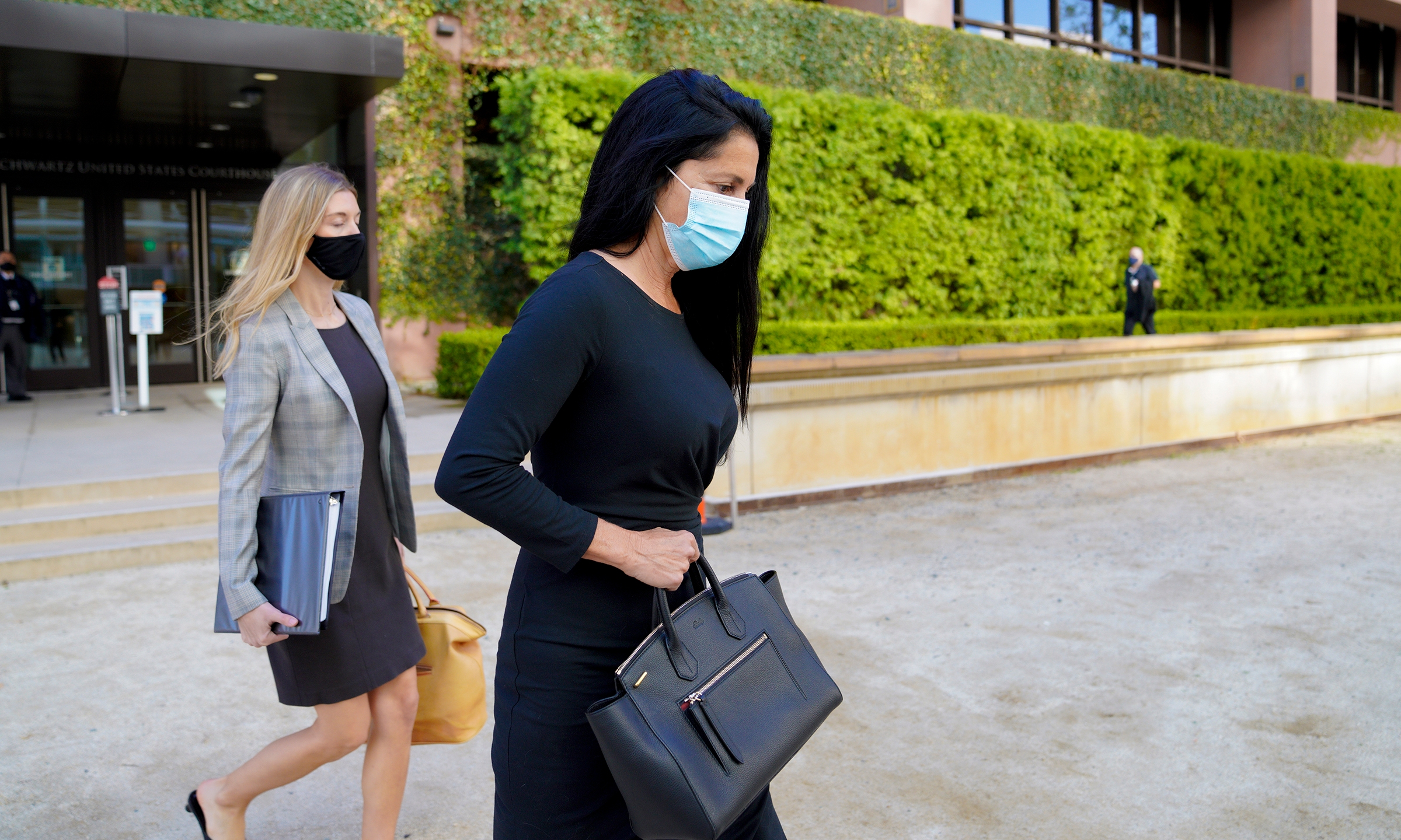 Gina Champion-Cain walks into Federal Court in San Diego for her sentencing hearing on March 31, 2021. (Nelvin C. Cepeda / The San Diego Union-Tribune via Associated Press)