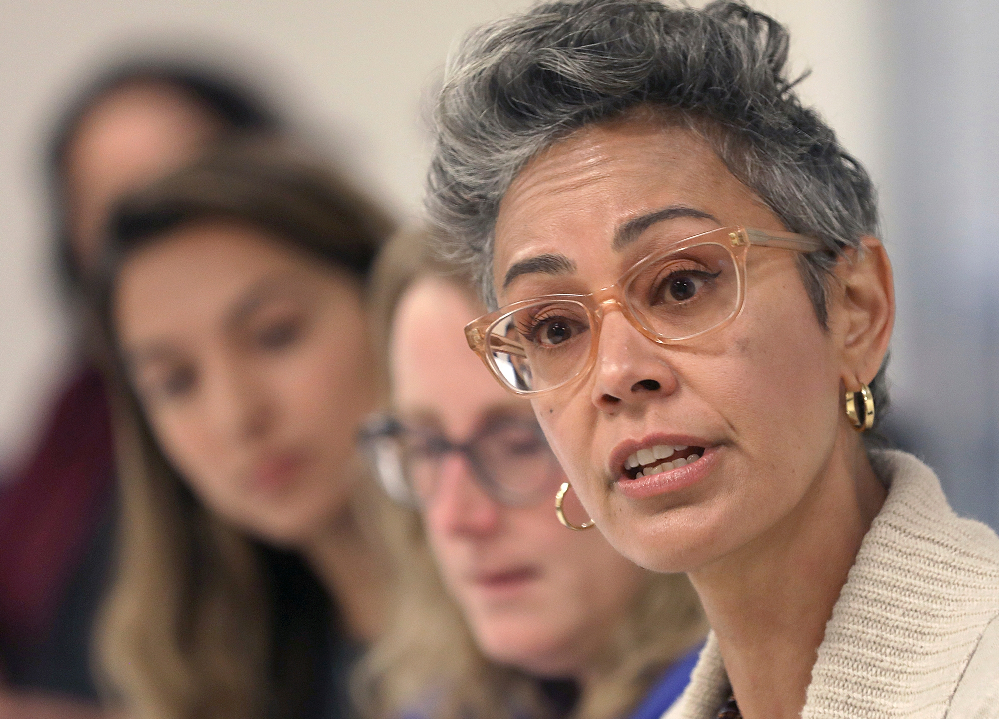 In this Sept. 26, 2018 file photo, Alison Collins, right, is seen during an editorial board meeting in San Francisco. (Liz Hafalia/San Francisco Chronicle via AP, File)