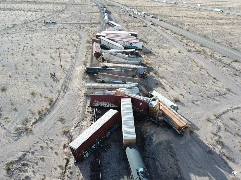 This photo released by the San Bernardino County Fire Department shows a derailed cargo train in the desert east of Ludlow that sent more than two dozen rail cars crashing into the sand on March 3, 2021.