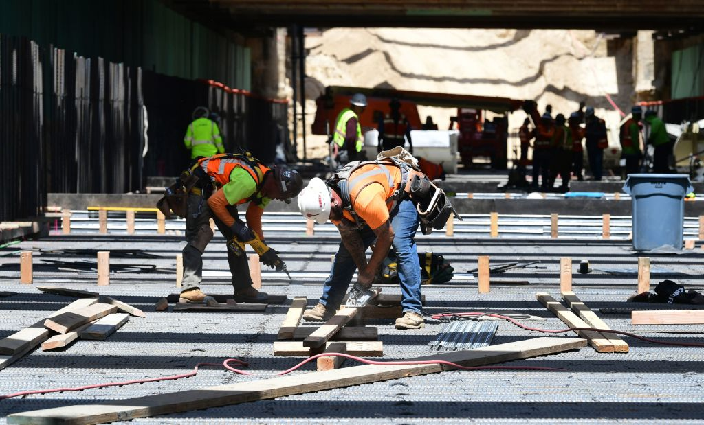 Construction workers in the Frenso Trench build a portion of the high-speed railway line on May 8, 2019. (FREDERIC J. BROWN / AFP / Getty Images)