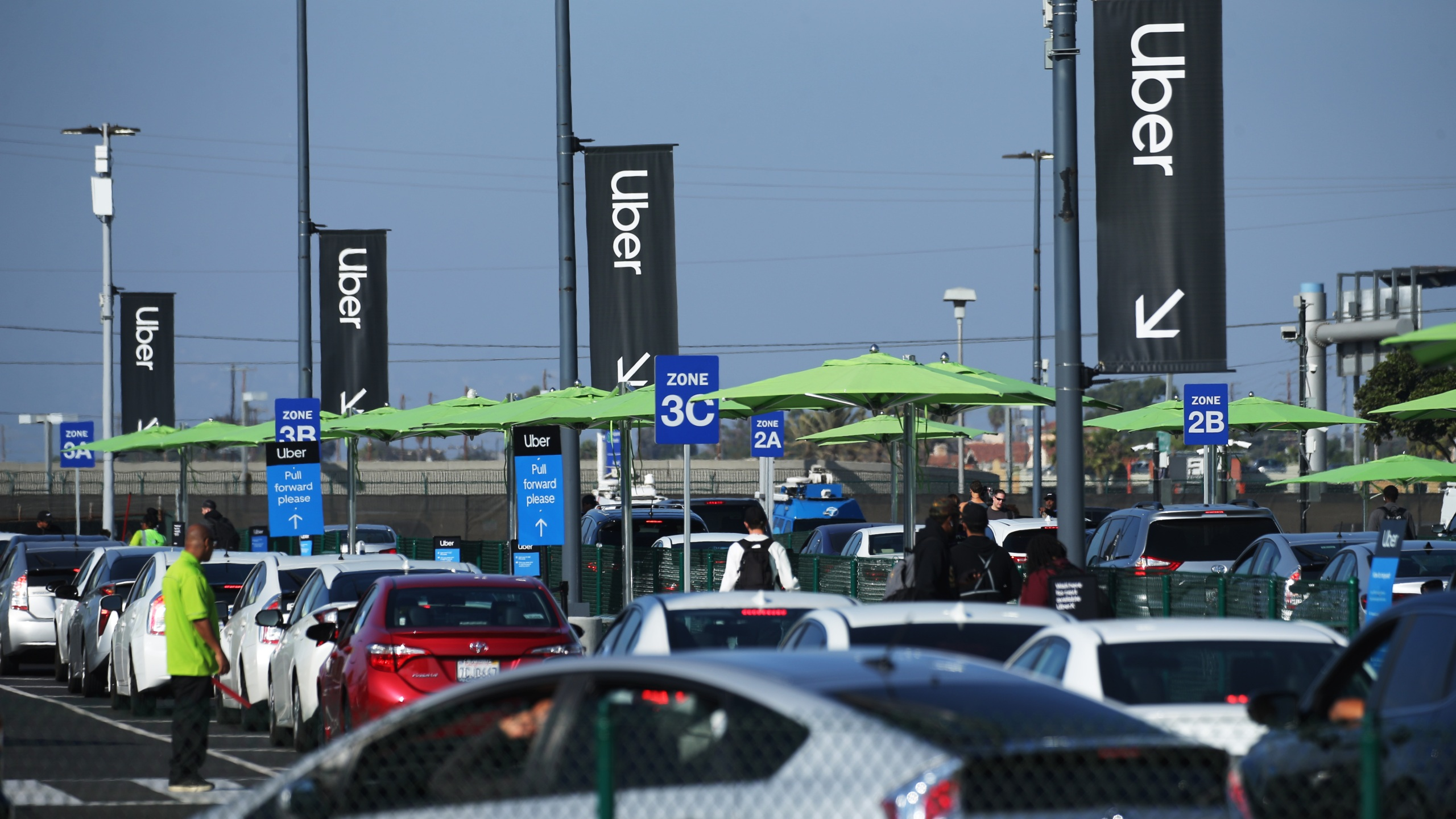 Uber vehicles are lined up at the 'LAX-it' ride-hail passenger pickup lot at Los Angeles International Airport on Nov. 6, 2019 in Los Angeles. (Mario Tama/Getty Images)
