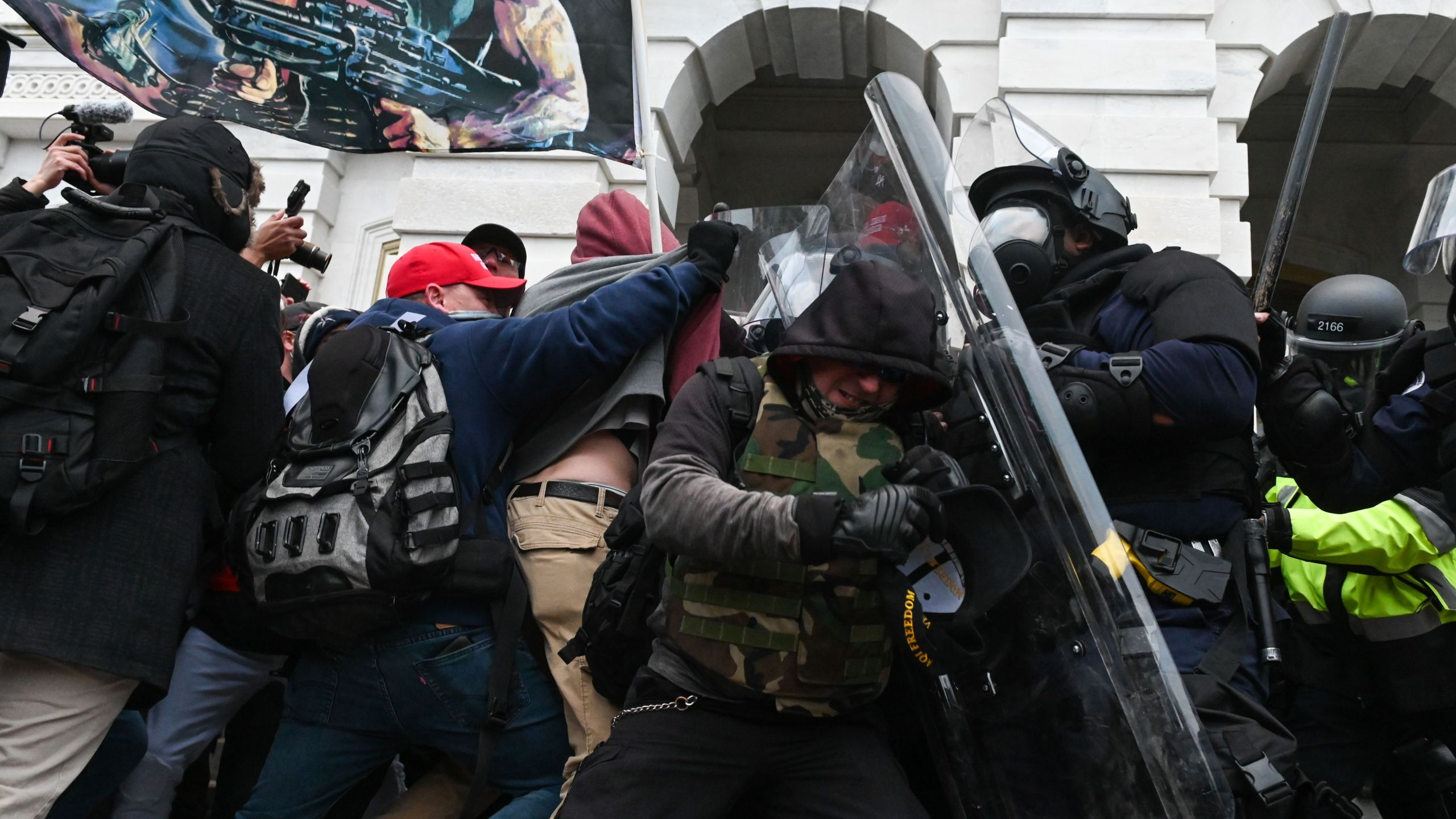 Riot police push back a crowd of supporters of President Donald Trump after they stormed the U.S. Capitol building on Jan. 6, 2021. (Roberto Schmidt / AFP / Getty Images)