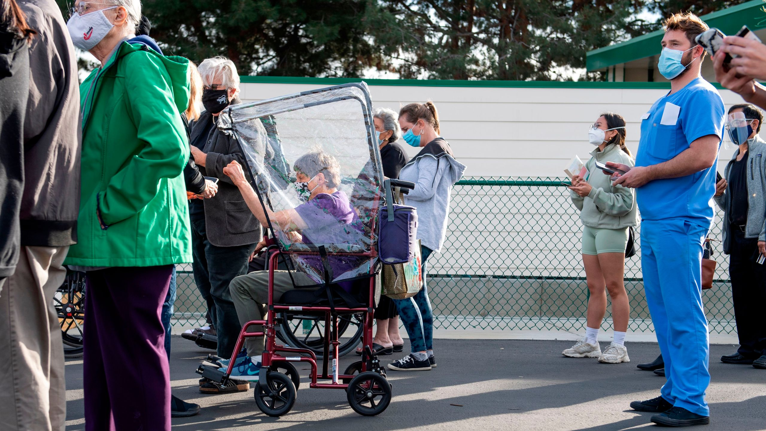 "People arrive at a Disneyland parking lot to receive Covid-19 vaccines on the opening day of the Disneyland Covid-19 vaccination ""super Point-of-Dispensing"" (POD) site, January 13, 2021, in Anaheim, California. (Photo by VALERIE MACON/AFP via Getty Images)"