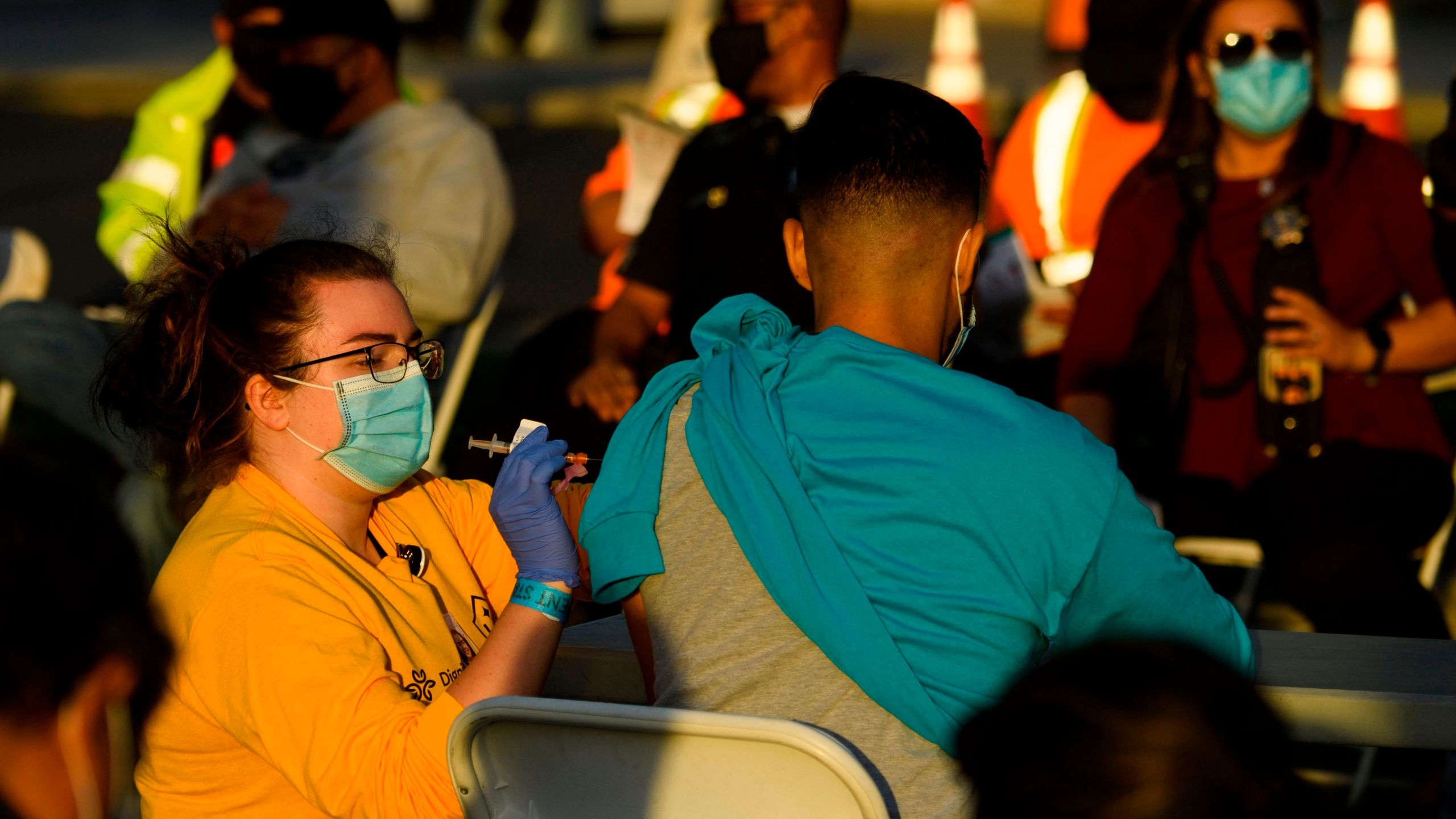 A nurse administers a dose of the Moderna COVID-19 vaccine at a vaccination site at Dignity Health Sports Park on Feb. 6, 2021, in Carson, California. (PATRICK T. FALLON/AFP via Getty Images)