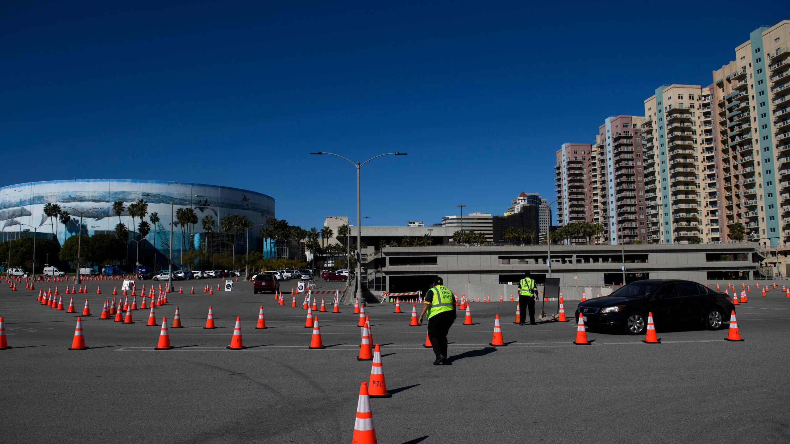 Vehicles drive to a post-vaccine recovery area after at a COVID-19 vaccination site on Feb.22, 2021 in Long Beach. (PATRICK T. FALLON/AFP via Getty Images)