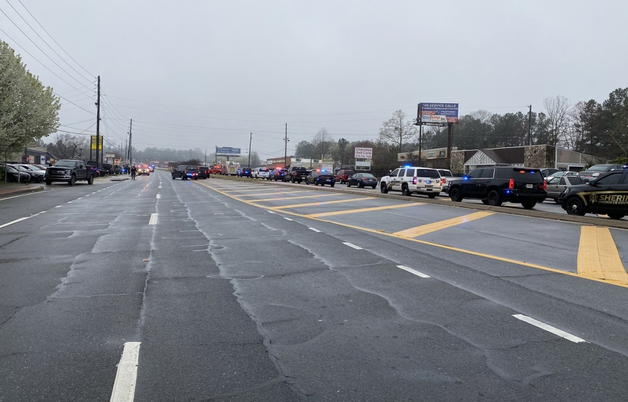 This handout photo courtesy of the Cherokee Sheriffs Office shows a line of law enforcement cars blocking the area of a shooting at a spa in an Atlanta suburb on March 16, 2021. (Cherokee Sheriffs Office/AFP via Getty Images)