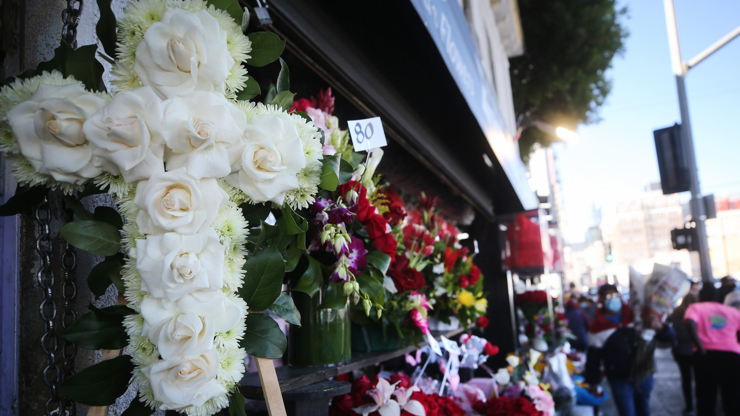 A floral cross for a funeral is displayed for sale in Los Angeles' flower district amid the COVID-19 pandemic on Feb. 12, 2021. (Mario Tama / Getty Images)