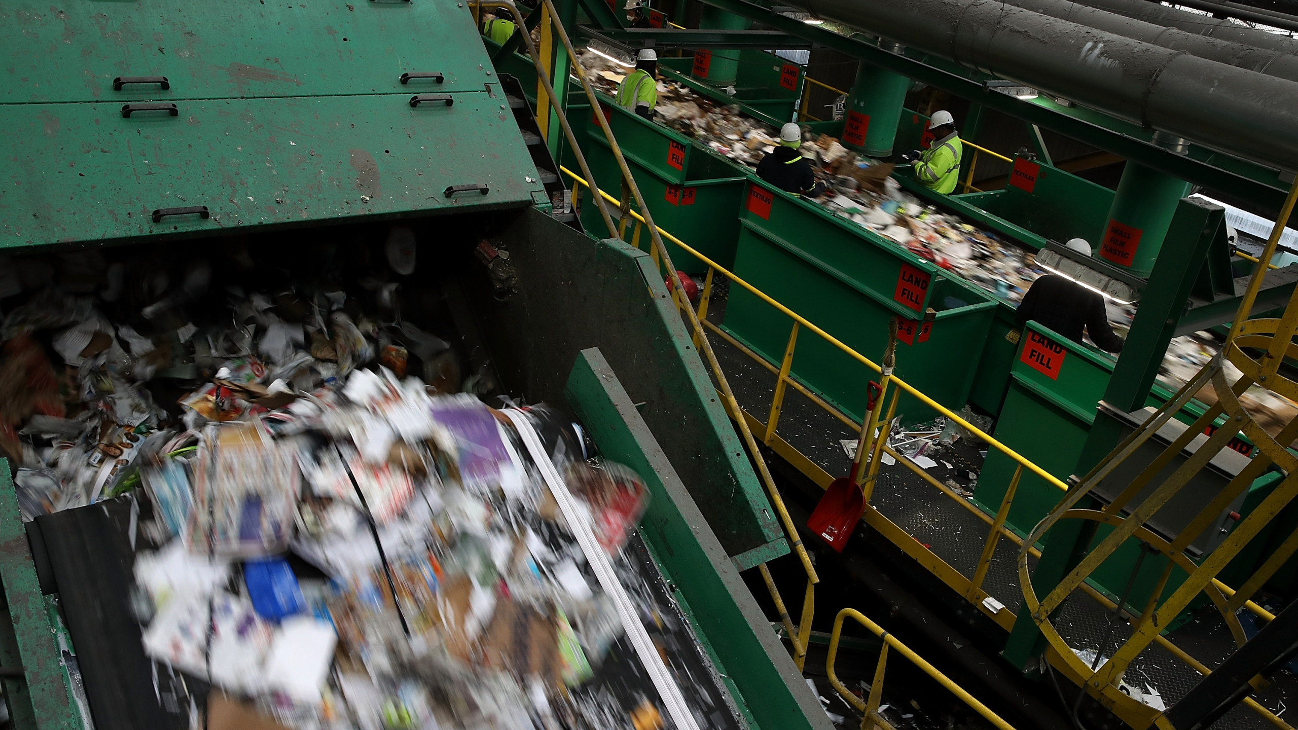 Workers sort through cardboard and mixed paper at Recology's Recylce Central on January 4, 2018 in San Francisco, California. (Justin Sullivan/Getty Images)
