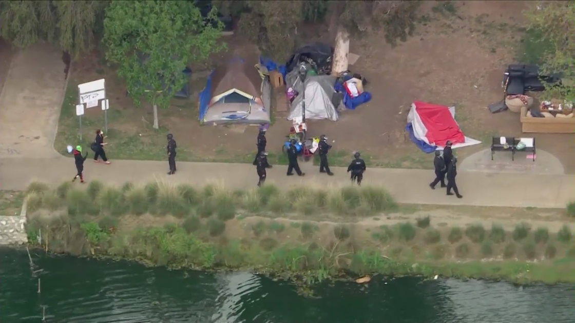 LAPD patrol Echo Park Lake amid a massive cleanup effort in March 2021. (KTLA)