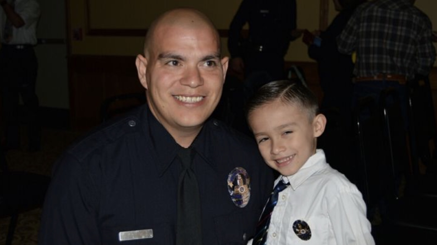 Officer Raul Ramirez is pictured with his son. (Courtesy GoFundMe)