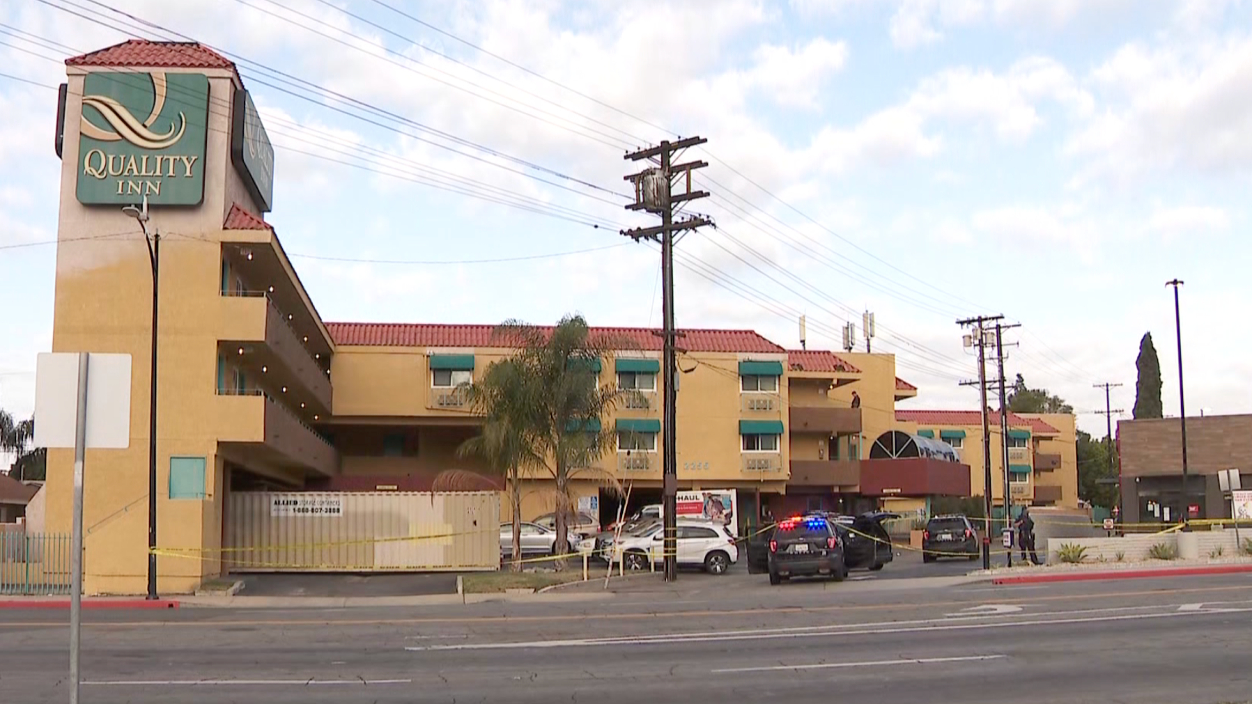 Authorities respond to investigate a deadly police shooting outside a Quality Inn in Burbank on March 8, 2021. (KTLA)