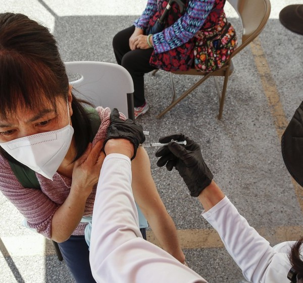 Registered nurse Cristy Michel administers a COVID-19 vaccination last week at a clinic in Chinatown.(Al Seib / Los Angeles Times)