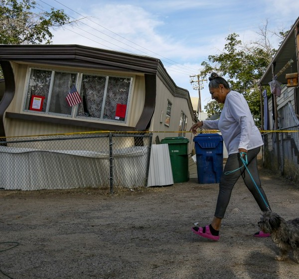 Carmen Rivera and her dog Ash pass by a dislodged mobile home following the Ridgecrest, Calif., earthquake in 2019. A new study suggests the long-awaited Big One may do less damage to the Los Angeles area than previously thought.(Irfan Khan / Los Angeles Times)