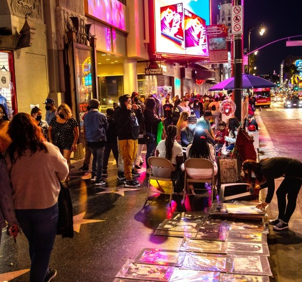 As Los Angeles County eases coronavirus-related restrictions, people fill the sidewalks along Hollywood Boulevard in Hollywood on March 20, 2021. (Jay L. Clendenin / Los Angeles Times)