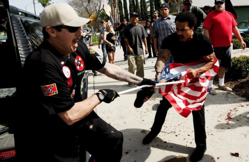 People clash during a 2016 Ku Klux Klan protest in Anaheim left three people with stab wounds. (Luis Sinco / Los Angeles Times)