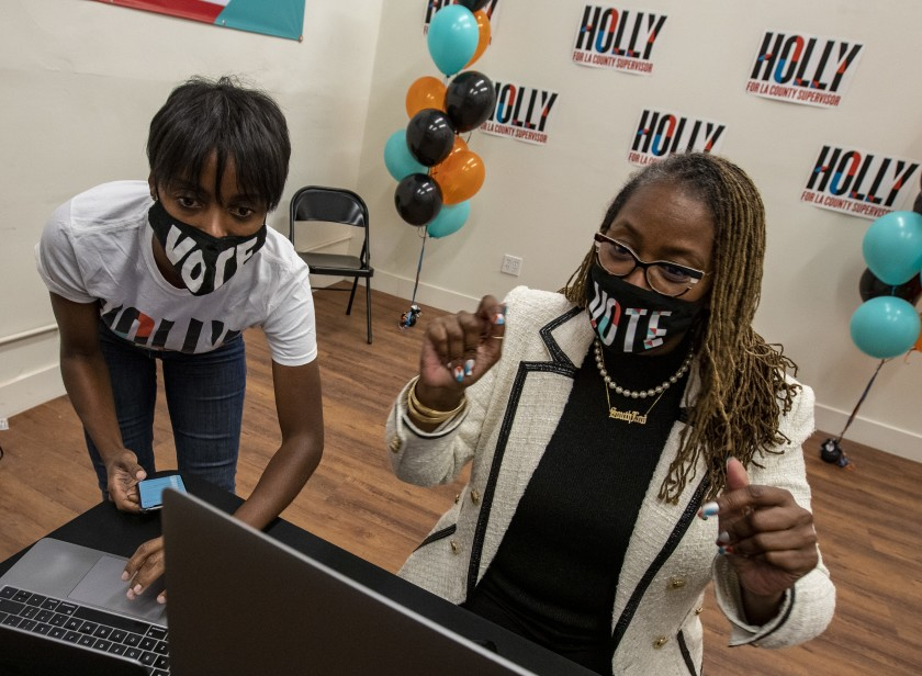 Holly Mitchell, right, and campaign manager Lenee Richards watched for election updates Nov. 3, 2020, during Mitchell's successful race against Herb Wesson for a seat on the Los Angeles County Board of Supervisors. (Brian van der Brug / Los Angeles Times)