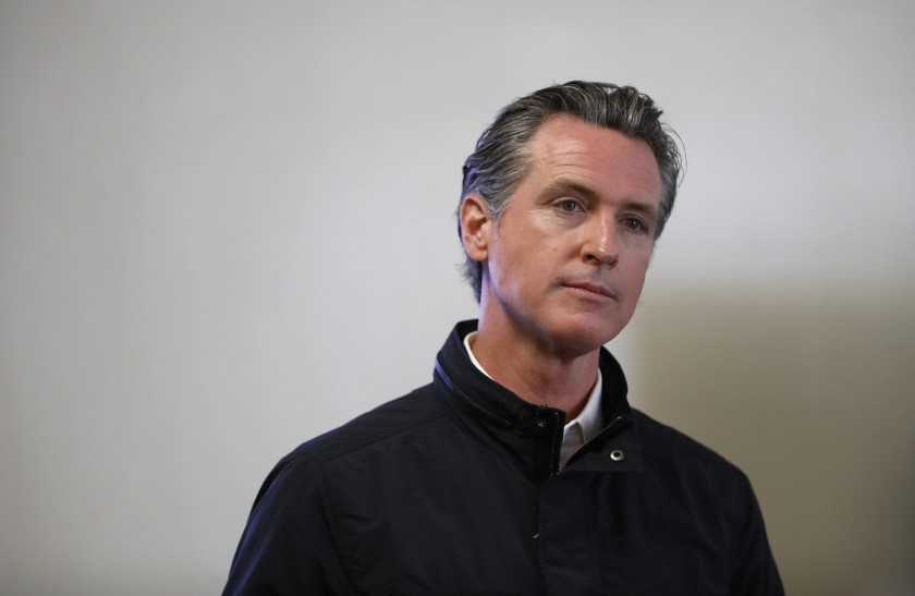 Gov. Gavin Newsom visits a vaccination site at South Gate Park in Los Angeles County on March 10, 2021. (Al Seib / Los Angeles Times)