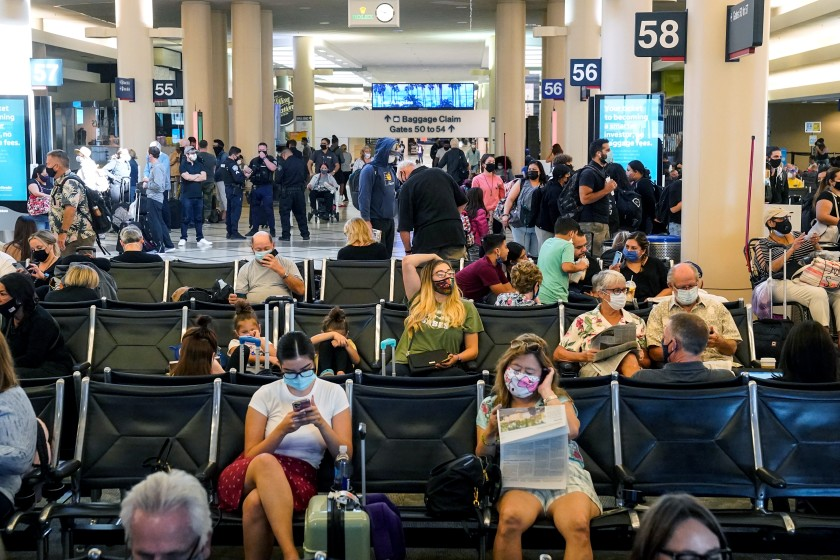 Travelers at Los Angeles International Airport in October 2020. Travel bookings are starting to increase, and prices for some popular destinations are also expected to climb.(Kent Nishimura / Los Angeles Times)