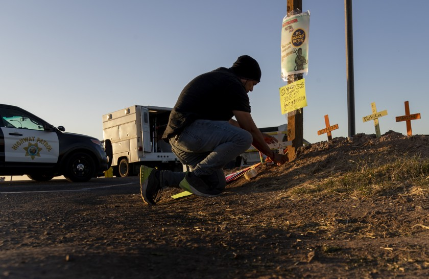 Hugo Castro, an activist with the Coalition for Human Immigration Rights, places crosses at the crash scene.(Gina Ferazzi/Los Angeles Times)