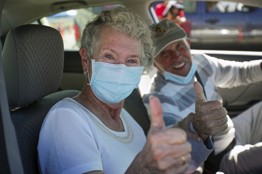 Hulene Dykstra and her husband Heinz Beer were in an upbeat mood after she got her first dose of the Moderna COVID-19 vaccine in San Bernardino County.(Irfan Khan / Los Angeles Times)
