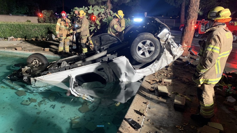 A vehicle is seen in a pool following a fatal crash in Garden Grove on March 12, 2021. (OCFA)