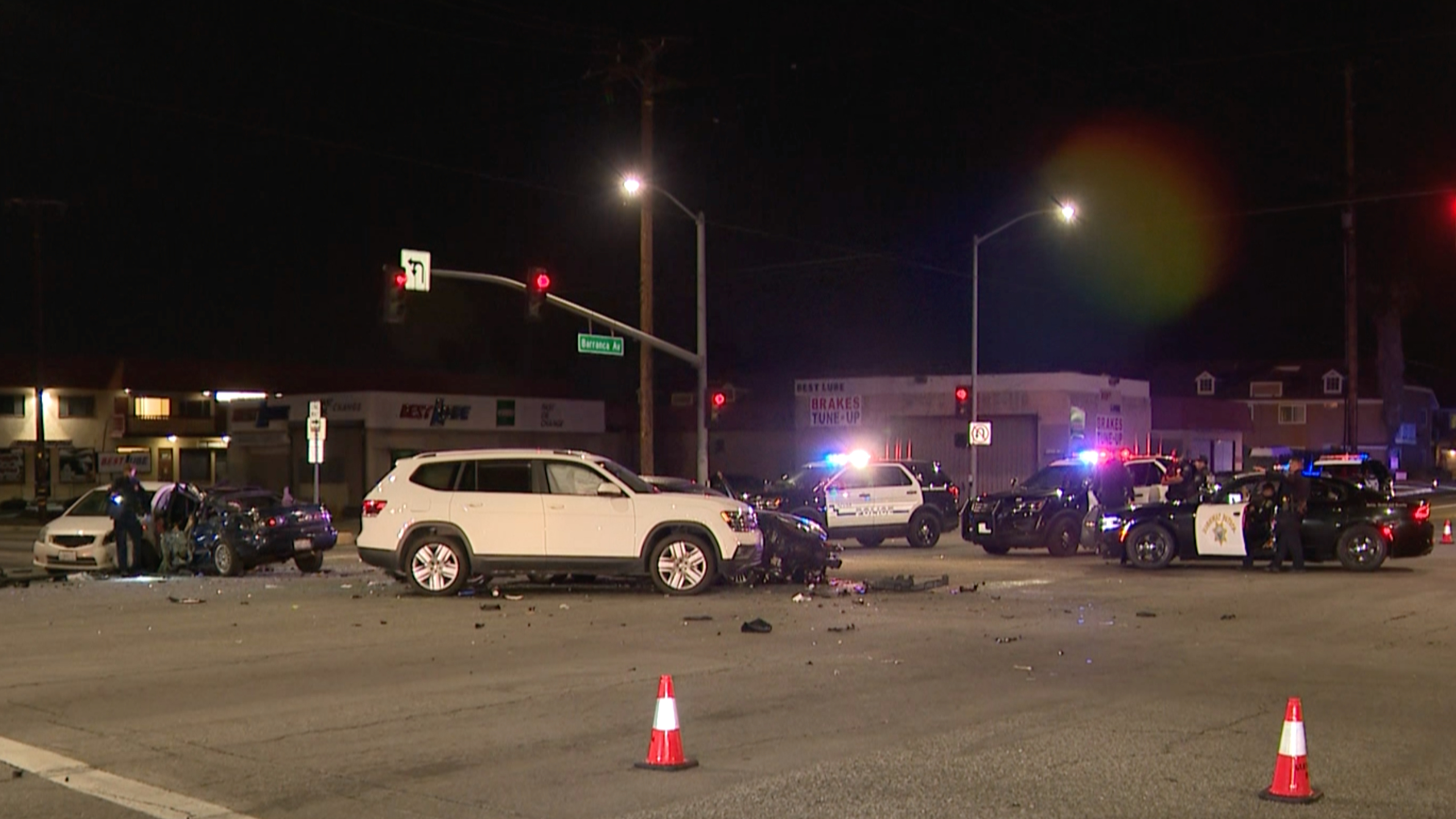 Authorities investigate the scene of a chain-reaction crash involving a stolen vehicle being chased by police in the Covina area on March 8, 2021. (KTLA)