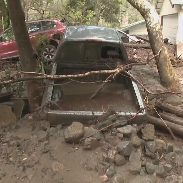 A truck is seen buried in debris following a mudslide in Silverado Canyon on March 10, 2021. (KTLA)