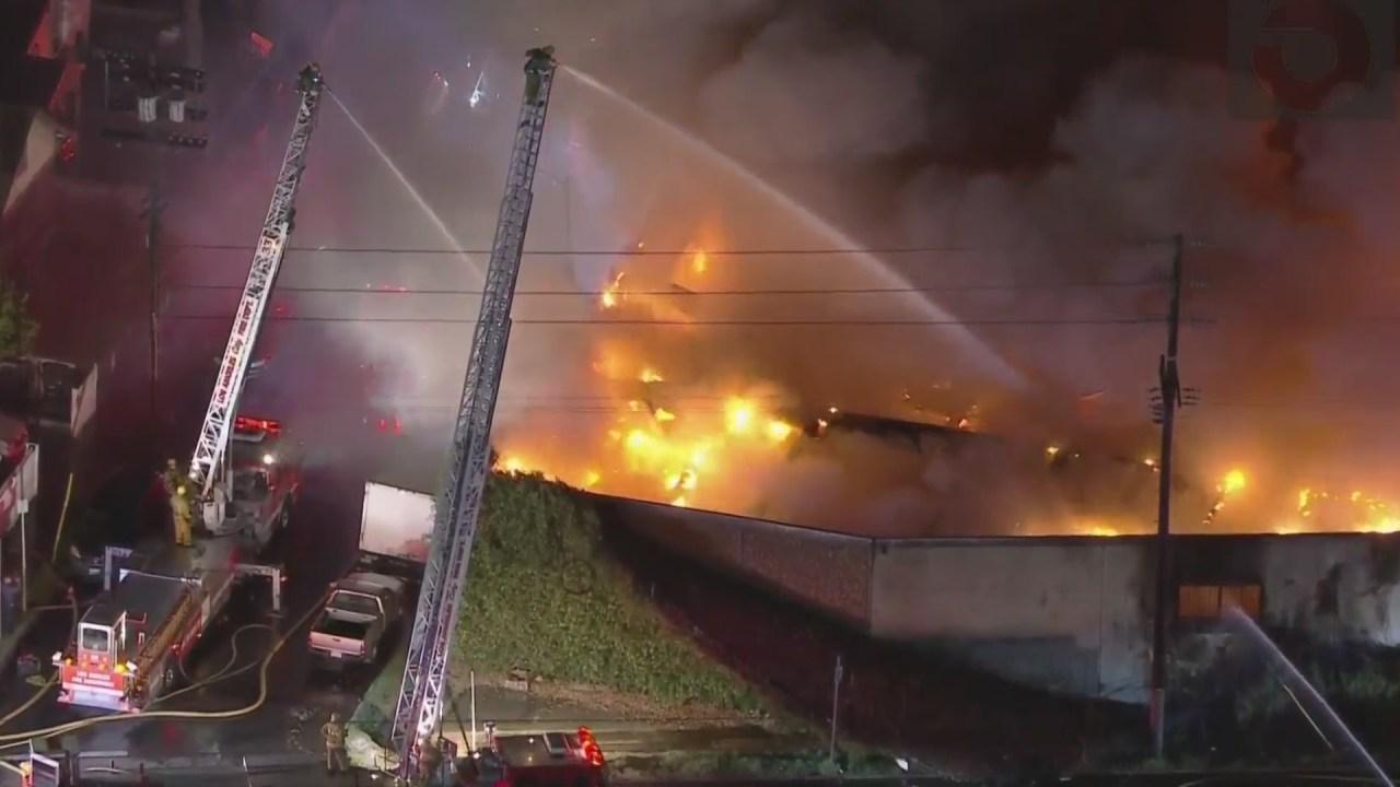 Fire crews battle blaze engulfing commercial building in South L.A.