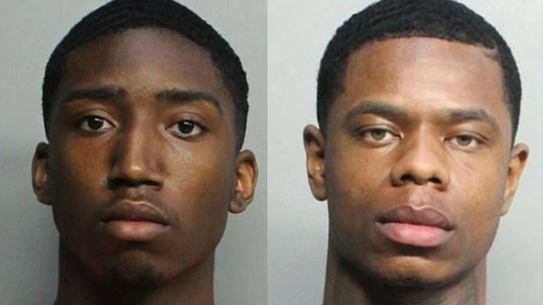 Evoire Collier and Dorian Taylor are seen in booking photos released by the Miami Beach Police Department.