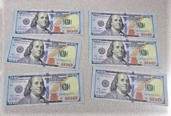 Fake $100 bills are seen in a photo released by CBP on March 22, 2021.