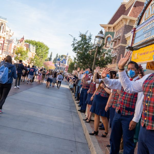 Cast members welcome back guests to Disneyland along Main Street on April 30, 2021. (Christian Thompson/Disneyland Resort)