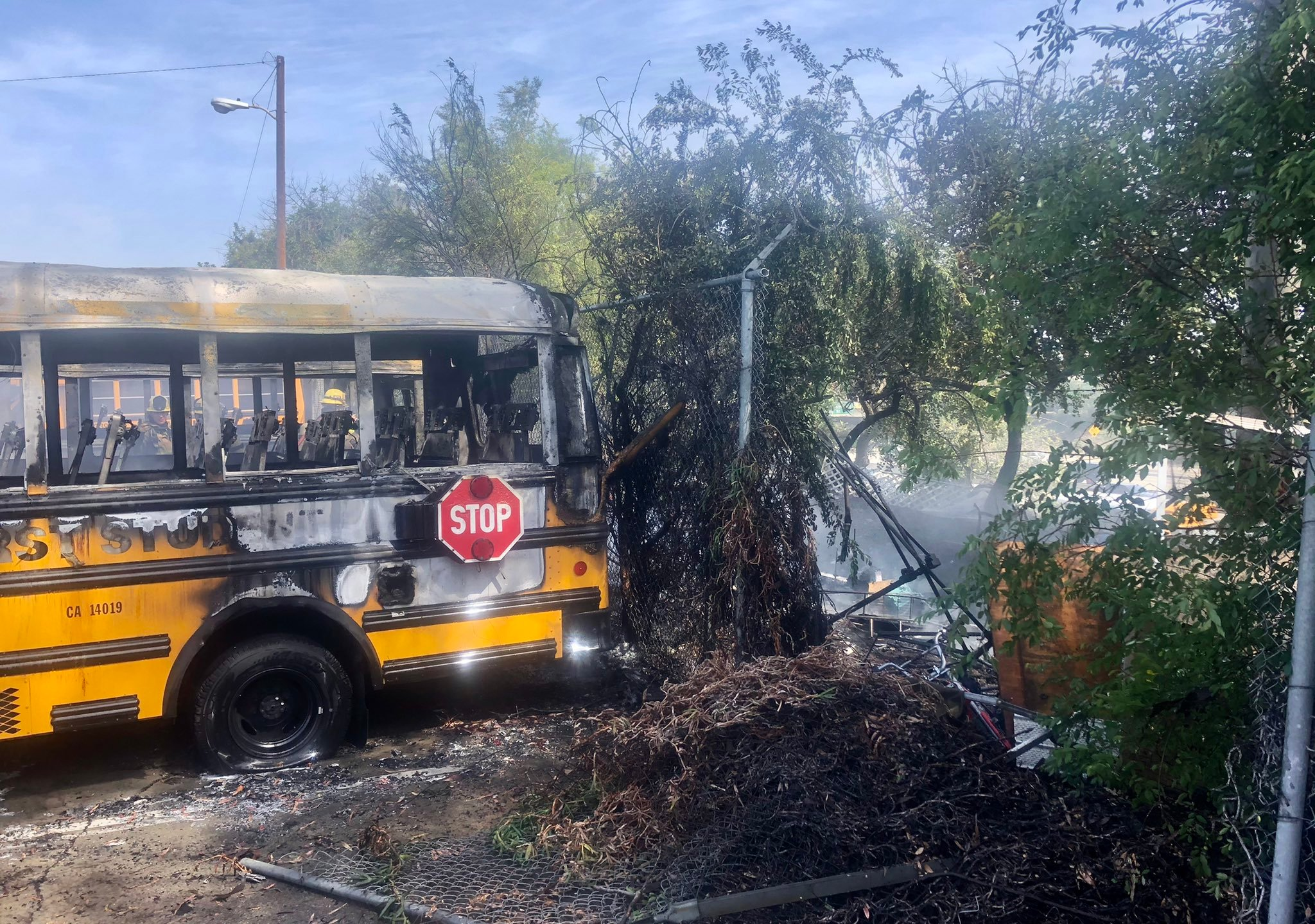 A small brush fire in Long Beach charred multiple unoccupied school buses on April 15, 2021. (Long Beach Fire Department)