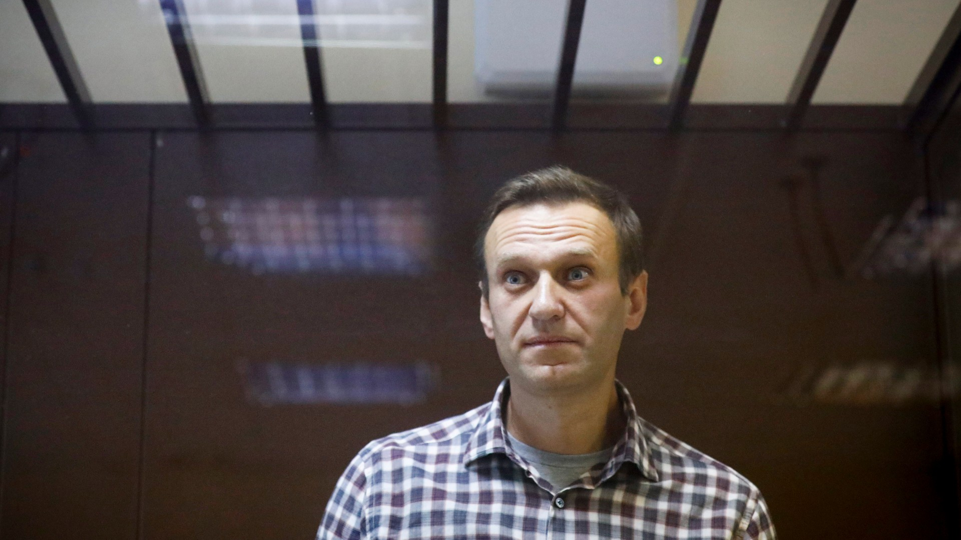 In this Feb. 20, 2021, file photo, Russian opposition leader Alexei Navalny stands in a cage in the Babuskinsky District Court in Moscow, Russia. (AP Photo/Alexander Zemlianichenko, File)