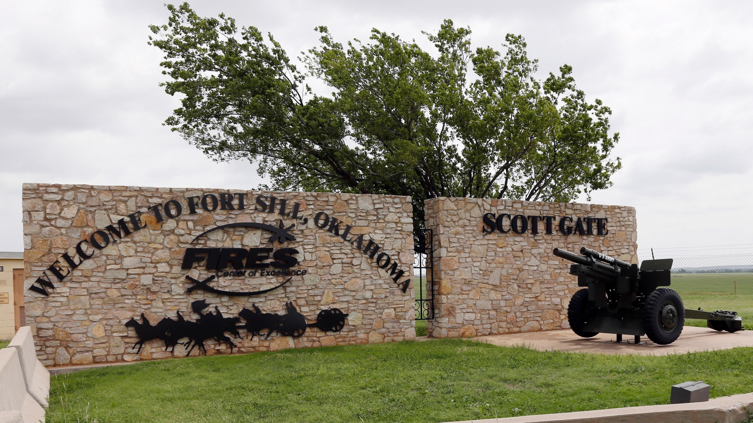 This June 17, 2014 file photo shows an entrance to Fort Sill near Lawton, Okla. (AP Photo/Sue Ogrocki, File)