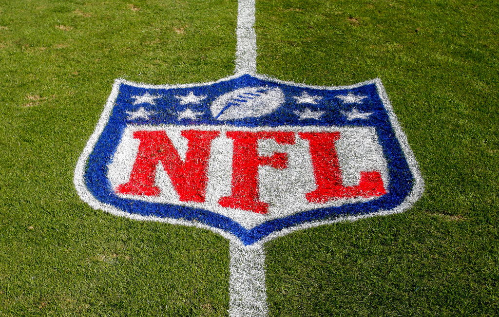 In this Nov. 4, 2018, file photo, the NFL logo is displayed on the field at the Bank of America Stadium before an NFL football game between the Tampa Bay Buccaneers and the Carolina Panthers in Charlotte, N.C. (AP Photo/Nell Redmond, File)