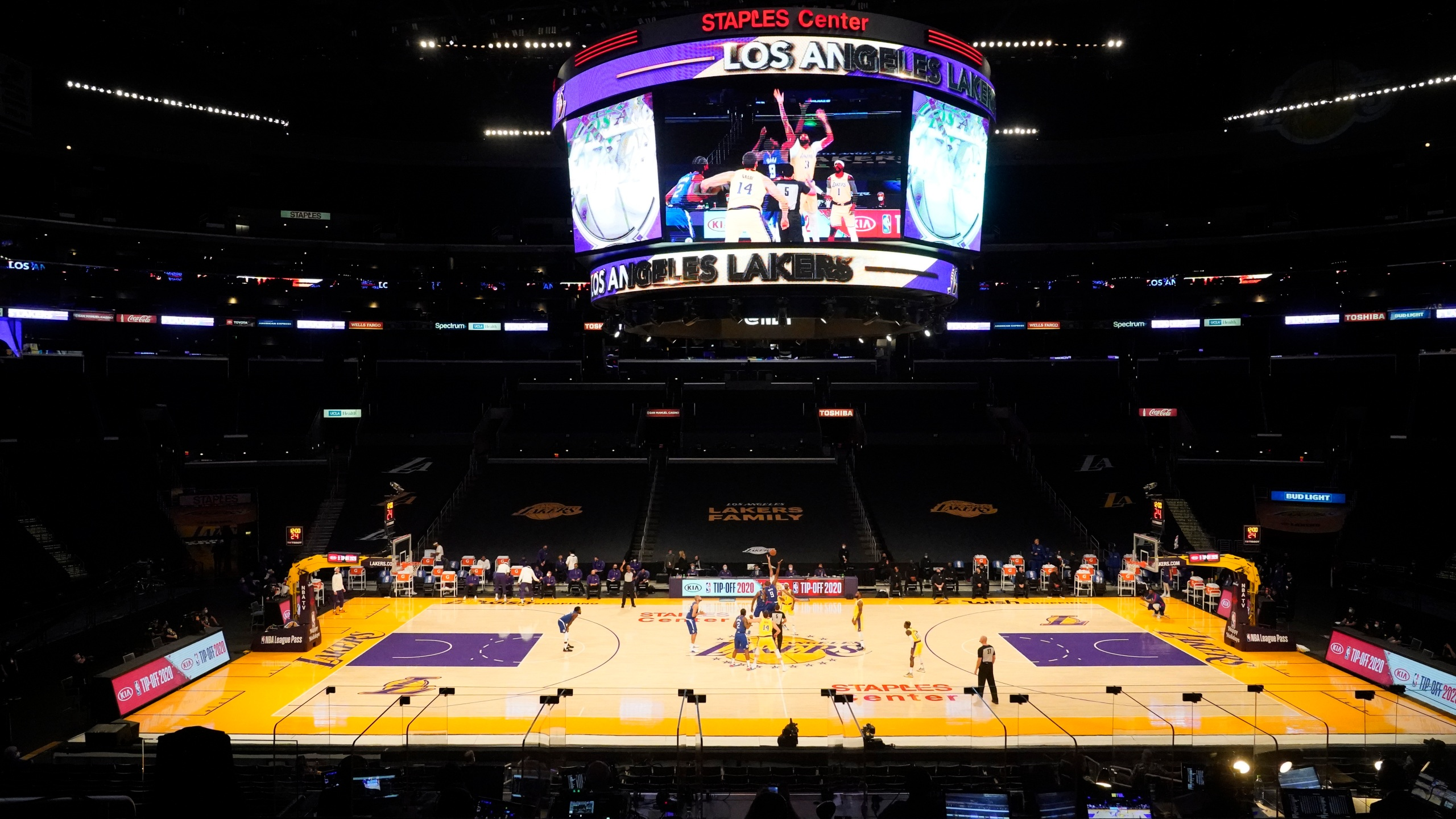 The Los Angeles Lakers and the Los Angeles Clippers tip off in an empty Staples Center amid the coronavirus pandemic, to start an NBA basketball game Dec. 22, 2020, in Los Angeles. (AP Photo/Marcio Jose Sanchez)