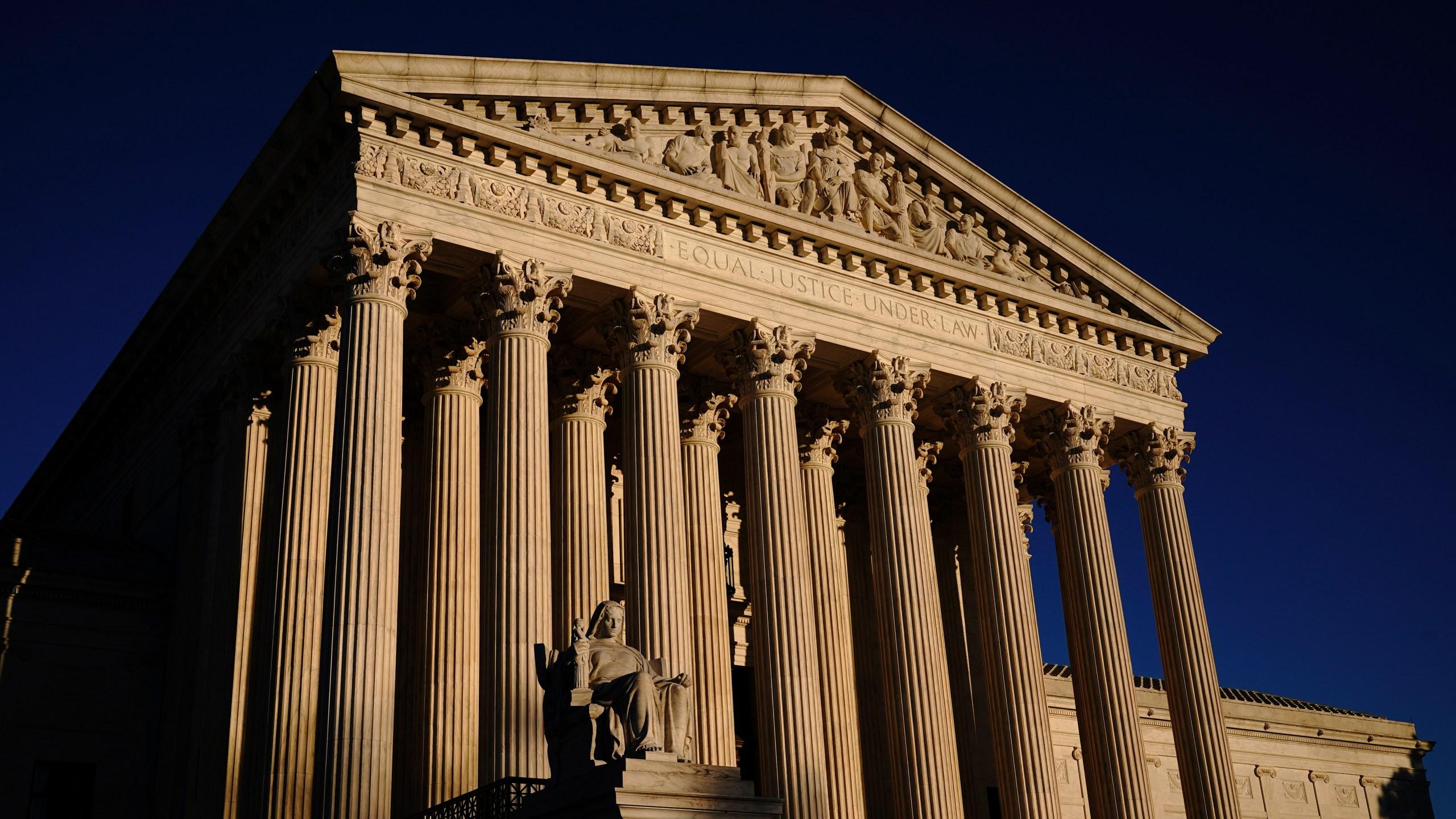 In this Nov. 2, 2020, file photo the Supreme Court is seen at sundown in Washington. (J. Scott Applewhite/Associated Press)