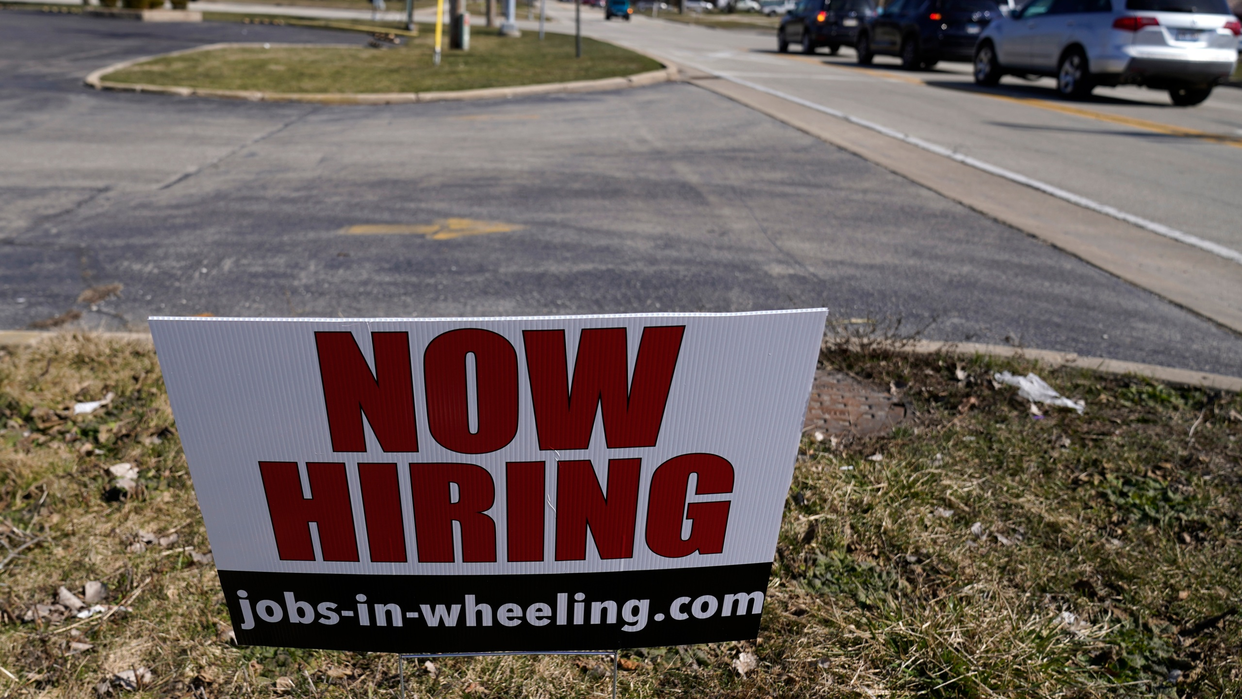 A hiring sign shows in Wheeling, Ill., Sunday, March 21, 2021. The number of Americans applying for unemployment aid fell last week to 547,000, a new low since the pandemic struck and a further encouraging sign that layoffs are slowing on the strength of an improving job market. The Labor Department said Thursday, April 22, that applications declined 39,000 from a revised 586,000 a week earlier. (AP Photo/Nam Y. Huh)