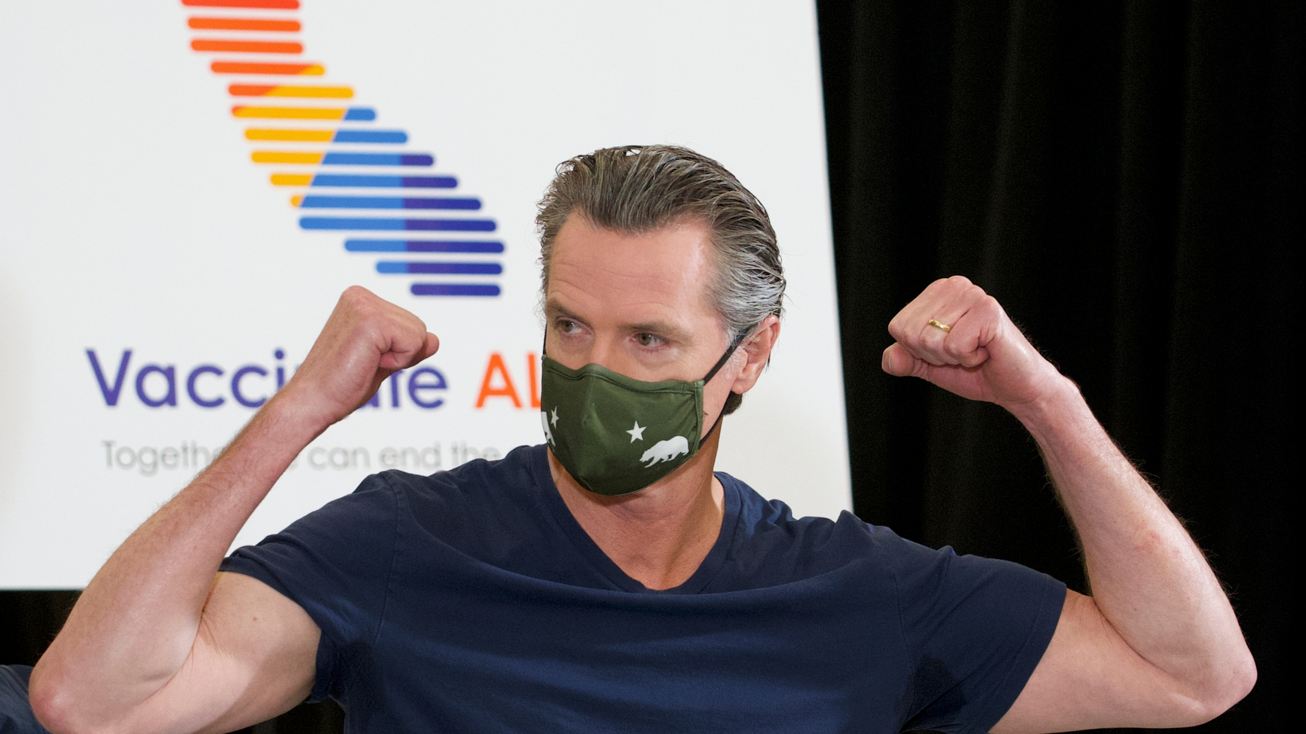 California Gov. Gavin Newsom reacts after being inoculated by Dr. Mark Ghaly, Secretary of California Health and Human Services, with the new one-dose Janssen COVID-19 vaccine at the Baldwin Hills Crenshaw Plaza in Los Angeles on April 1, 2021. (AP Photo/Damian Dovarganes)